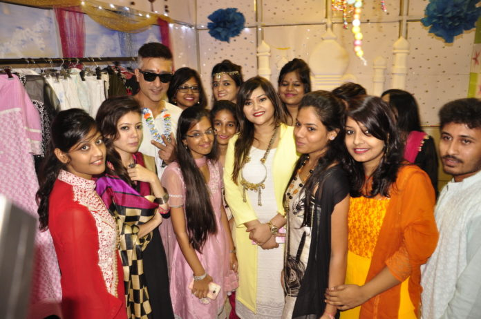Actors Koneenica Banerjee (in yellow) And Shataf (in white) With INIFD Students At Their Annual Exhibition 2016.