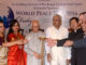"""Governor of West Bengal Keshari Nath Tripathi (C) with Consulates in Kolkata USA, China, Germany, Nepal & others also lighting """"Peace Lamp"""" during """"World Peace Day"""""""