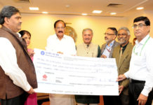 Dividend cheque by the CMD, HUDCO