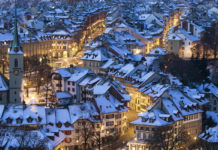 Snow covers the roofs of the houses in the city of Bern, Switzerland.