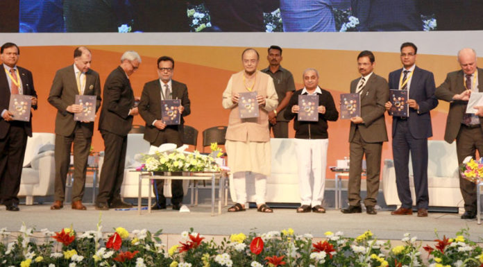 """The Union Finance Minister Shri Arun Jaitley releasing a book at the seminar on """"GST: The game changer for Indian Economy"""" during the Vibrant Gujarat Global Summit 2017, at Mahatma Mandir, in Gandhinagar, Gujarat on January 11, 2017."""