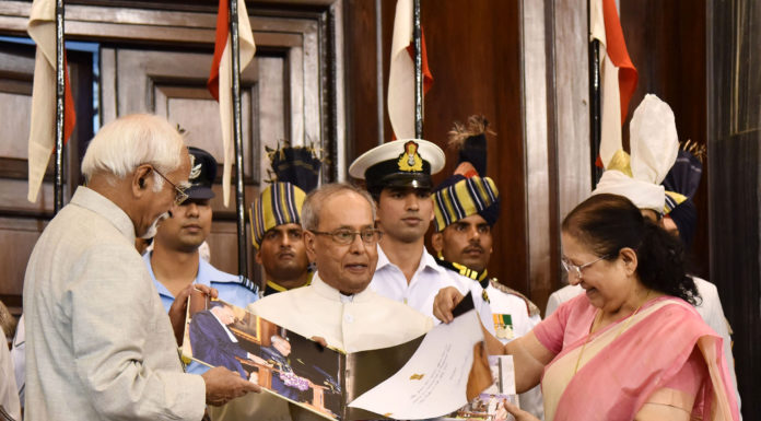 The President, Shri Pranab Mukherjee being presented a coffee-table book by the Vice President and the Chairman, Rajya Sabha, Shri M. Hamid Ansari and the Speaker, Lok Sabha, Smt. Sumitra Mahajan, during his farewell function, at Central Hall of the Parliament, in New Delhi on July 23, 2017.