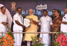 The Prime Minister, Shri Narendra Modi distributing the Sanction Letters to beneficiaries of Long Liner Trawlers under 'Blue Revolution Scheme', at Rameswaram, Tamil Nadu on July 27, 2017. The Chief Minister of Tamil Nadu, Shri Edappadi K. Palaniswami, the Minister of State for Commerce & Industry (Independent Charge), Smt. Nirmala Sitharaman and other dignitaries are also seen.
