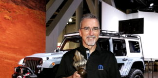 "Pietro Gorlier, Head of Parts and Service (Mopar) - FCA, with the ""Hottest 4x4-SUV"" award, claimed by the Jeep(r) Wrangler for the eighth consecutive year at the Specialty Equipment Market Association (SEMA) Show in Las Vegas. (PRNewsfoto/FCA US LLC)"