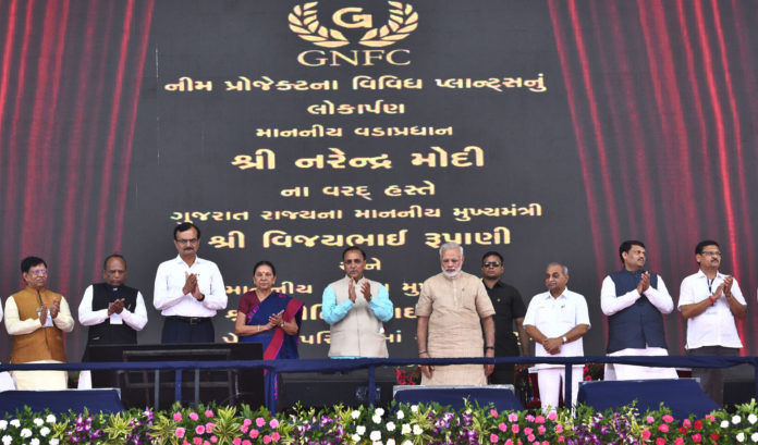 The Prime Minister, Shri Narendra Modi inaugurates the various plants of Gujarat Narmada Fertilizers Corporation Ltd., at Bharuch, in Gujarat on October 08, 2017. The Chief Minister of Gujarat, Shri Vijay Rupani, the Deputy Chief Minister of Gujarat, Shri Nitinbhai Patel and other dignitaries are also seen.