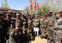 The Prime Minister, Shri Narendra Modi celebrating the Diwali with the jawans of the Indian Army and BSF, in the Gurez Valley, near the Line of Control, in Jammu and Kashmir, on October 19, 2017. The Chief of Army Staff, General Bipin Rawat is also seen.