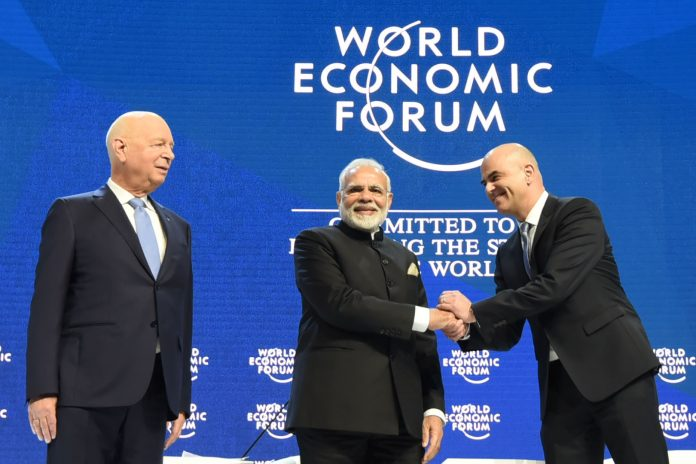 The Prime Minister, Shri Narendra Modi with the President of the Swiss Confederation, Mr. Alain Berset and the Chairman of the World Economic Forum, Professor Klaus Schwab, at the plenary session of the World Economic Forum, in Davos on January 23, 2018.