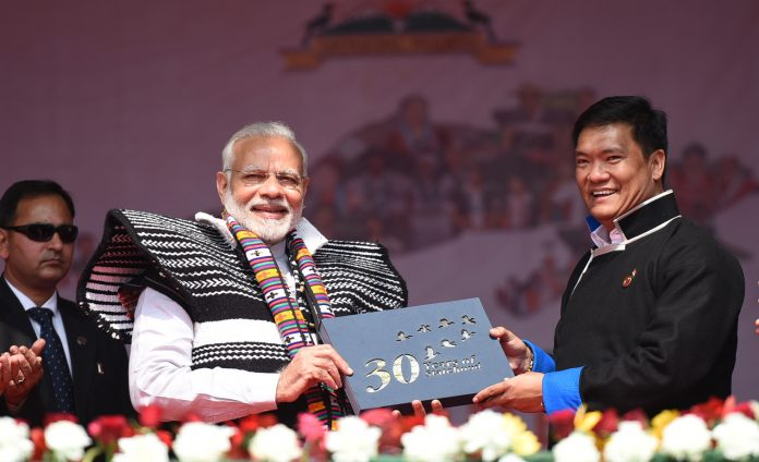 The Prime Minister, Shri Narendra Modi at the inauguration of the Dorjee Khandu State Convention Centre, in Itanagar, Arunachal Pradesh on February 15, 2018. The Chief Minister of Arunachal Pradesh, Shri Pema Khandu is also seen.