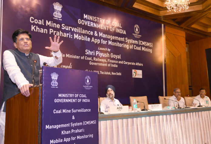 """The Union Minister for Railways, Coal, Finance and Corporate Affairs, Shri Piyush Goyal addressing at the launch of the Coal Mine Surveillance & Management System (CMSMS) and Mobile App """"Khan Prahari"""", in New Delhi on July 04, 2018. The Secretary, Ministry of Coal, Shri Inderjit Singh and other dignitaries are also seen."""