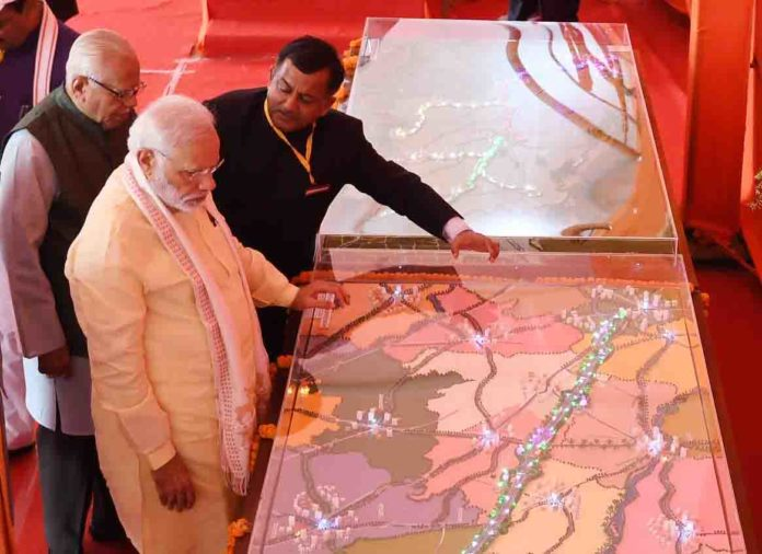 The Prime Minister, Shri Narendra Modi at the foundation stone laying ceremony of Poorvanchal Expressway, in Azamgarh, Uttar Pradesh on July 14, 2018. The Governor of Uttar Pradesh, Shri Ram Naik is also seen.