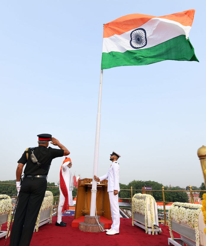 The Prime Minister, Shri Narendra Modi unfurling the Tricolour flag at the ramparts of Red Fort, on the occasion of 72nd Independence Day, in Delhi on August 15, 2018.