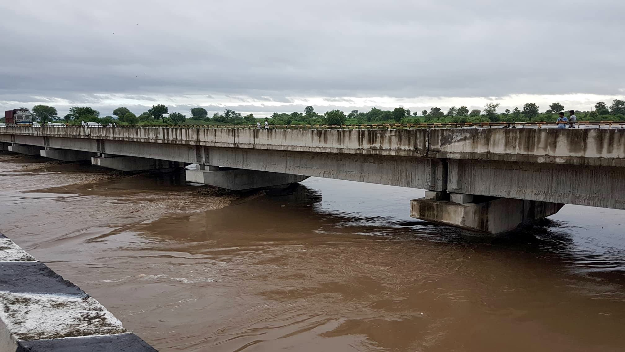 The cleanup act.. water flowing under the Painganga bridge about 20 feet higher than normal