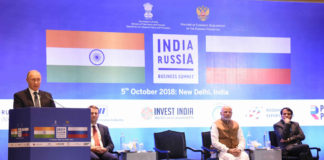 The President of Russian Federation, Mr. Vladimir Putin addressing at the India-Russia Business Summit, in New Delhi on October 05, 2018. The Prime Minister, Shri Narendra Modi and the Union Minister for Commerce & Industry and Civil Aviation, Shri Suresh Prabhakar Prabhu are also seen.