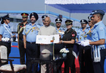 The President and Supreme Commander of the Indian Armed Forces, Shri Ram Nath Kovind releasing the First Day Covers of Air Defence College, at Air Force Station Guwahati on November 29, 2018. The Chief of the Air Staff, Air Chief Marshal B.S. Dhanoa is also seen.