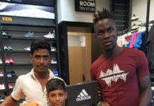 PHILIP ADJAH HELPS YOUNG FOOTBALLER