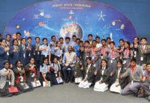 """The Chairman ISRO, Space Commission and Secretary, Department of Space, Dr. K. Sivan in a group photograph with the students during the """"Samwad with Students"""" (SwS), part of the enhanced outreach programme of ISRO, in Bengaluru on January 01, 2019."""