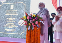 The Prime Minister, Shri Narendra Modi inaugurates the four laning of the Falakata - Salsalabari section of NH-31 D and inaugurates Circuit Bench of Calcutta High Court, at Jalpaiguri, West Bengal on February 08, 2019. The Minister of State for Electronics & Information Technology, Shri S.S. Ahluwalia is also seen.