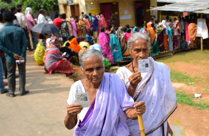 The elderly female voters displaying identity cards, at a polling booth, during the 1st Phase of General Elections-2019, at West Tripura on April 11, 2019.