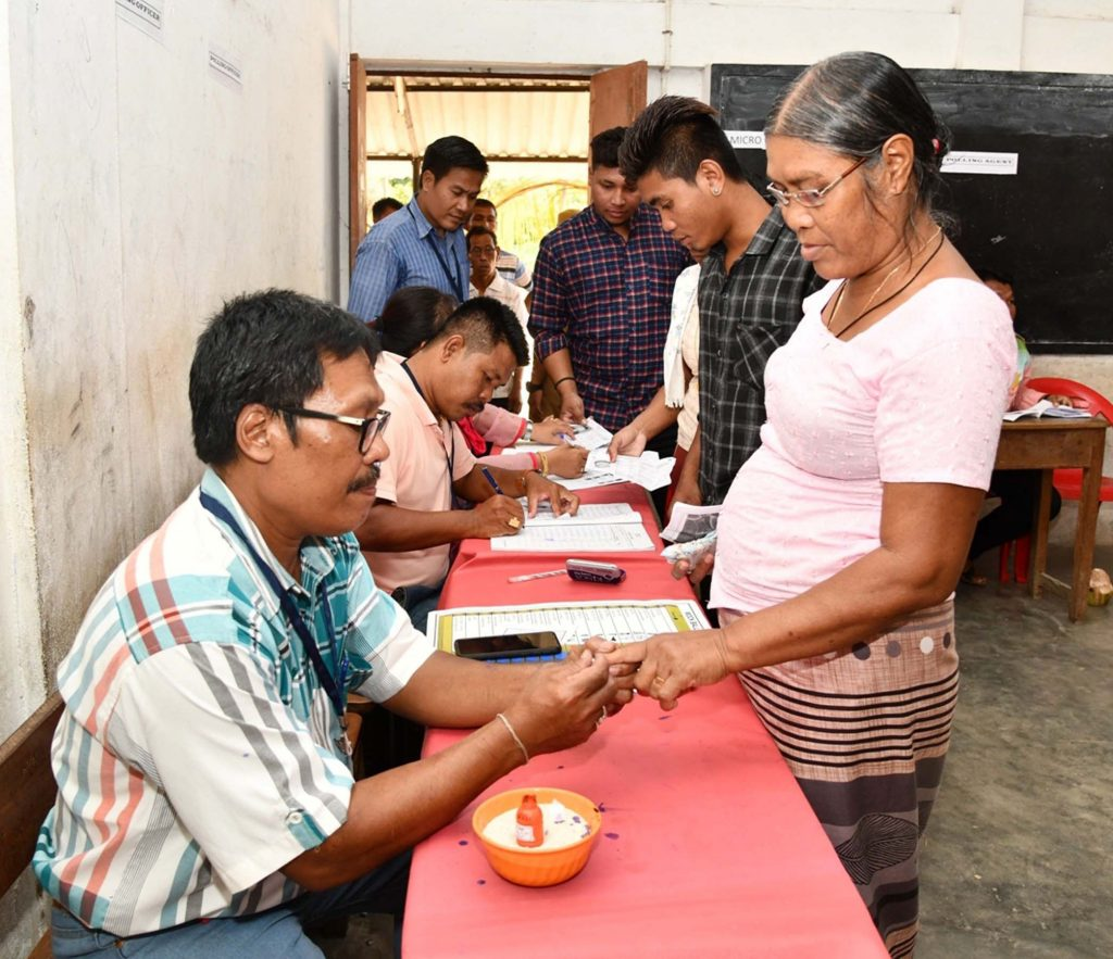 A polling official administering indelible ink to a voter, at a polling booth, during the 1st Phase of General Elections-2019, in Car Nicobar, Andaman and Nicobar Islands on April 11, 2019.