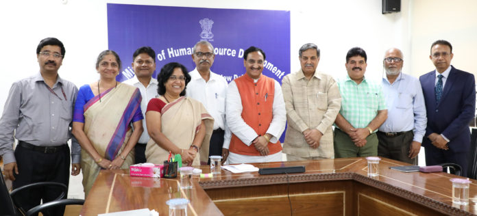 The Union Minister for Human Resource Development, Dr. Ramesh Pokhriyal 'Nishank' with the Full Commission UGC, in New Delhi on August 02, 2019.