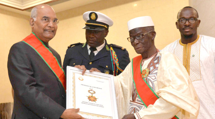 The President, Shri Ram Nath Kovind conferring with the National Order of Merit, the Highest Award of Guinea by the President of the Republic of Guinea, Mr. Alpha Conde, in Conakry, Republic of Guinea on August 02, 2019.
