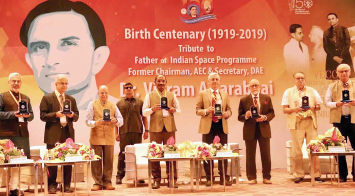 The Chairman, Indian Space Research Organisation (ISRO), Dr. K. Sivan along with other dignitaries releasing the coffee table book on ISRO through pictures, during the inaugural function of birth centenary celebration of Dr. Vikram Sarabhai, at Gujarat University Convention & Exhibition Center, in Ahmedabad on August 12, 2019.