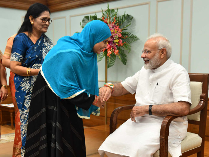 Women tying 'Rakhi' on the wrist of the Prime Minister, Shri Narendra Modi, on the occasion of 'Raksha Bandhan', in New Delhi on August 15, 2019.