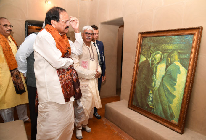 The Vice President of India, Shri M. Venkaiah Naidu looking at the portrait of Rabindranath Tagore and Mahatma Gandhi at 'Shyamoli', the ancestral house of Gurudeb Rabindranath Tagore renovated by the Archaeological Survey of India, in Kolkata on August 16, 2019.