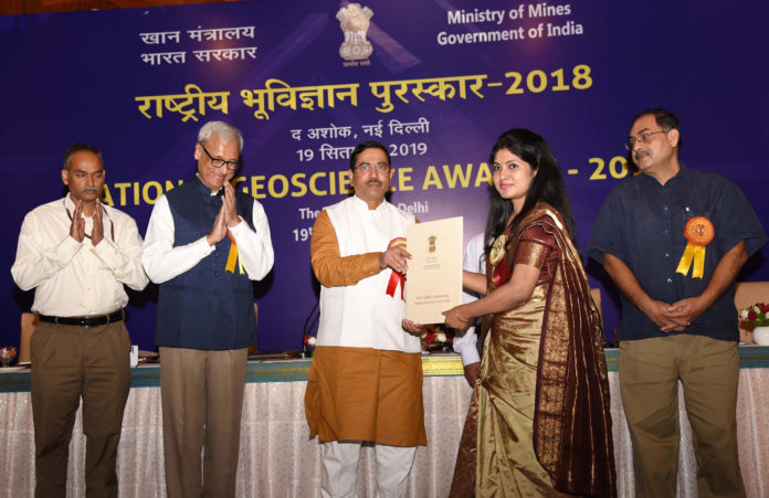 The Union Minister for Parliamentary Affairs, Coal and Mines, Shri Pralhad Joshi presenting the National Geoscience Awards - 2018, at a function, in New Delhi on September 19, 2019. The Secretary, Ministry of Mines, Shri Anil Gopishankar Mukim and other dignitaries are also seen.