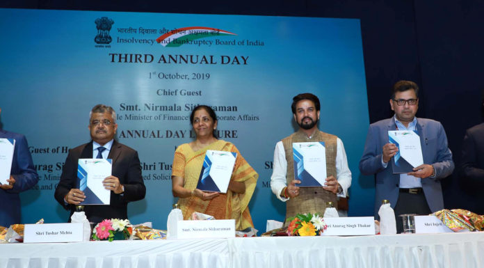 The Union Minister for Finance and Corporate Affairs, Smt. Nirmala Sitharaman releasing the publication, at the third Annual Day of Insolvency and Bankruptcy Board of India (IBBI), in New Delhi on October 01, 2019. The Minister of State for Finance and Corporate Affairs, Shri Anurag Singh Thakur, the Secretary, Ministry of Corporate Affairs, Shri Injeti Srinivas and other dignitaries are also seen.