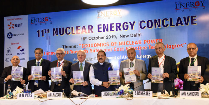 The Minister of State for Development of North Eastern Region (I/C), Prime Minister's Office, Personnel, Public Grievances & Pensions, Atomic Energy and Space, Dr. Jitendra Singh releasing the publication, at the inauguration of the 11th Nuclear Energy Conclave, in New Delhi on October 18, 2019. The Chairman, Department of Atomic Energy (DAE), Shri K.N. Vyas and other dignitaries are also seen.