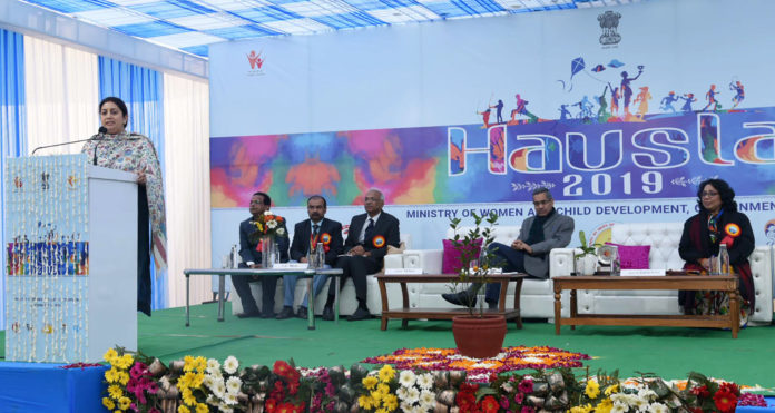 The Union Minister for Women & Child Development and Textiles, Smt. Smriti Irani addressing at the 'Bal Panchayat' as part of Hausla - a cultural & sports festival hosted by the Ministry of Women & Child Development, in New Delhi on December 19, 2019. The Secretary, Ministry of Women and Child Development, Shri Rabindra Panwar and other dignitaries are also seen.