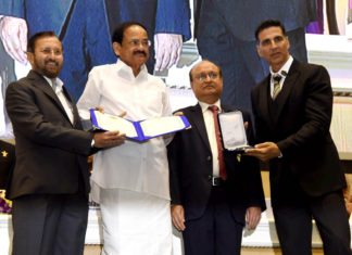 The Vice President, Shri M. Venkaiah Naidu presenting the Rajat Kamal Award to Shri Akshay Kumar for Best Film on Social Issues: Padman, at the 66th National Film Awards function, in New Delhi on December 23, 2019. The Union Minister for Environment, Forest & Climate Change, Information & Broadcasting and Heavy Industries and Public Enterprise, Shri Prakash Javadekar and the Secretary, Ministry of Information & Broadcasting, Shri Ravi Mittal are also seen.
