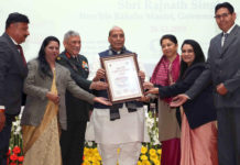 The Union Minister for Defence, Shri Rajnath Singh giving away the Raksha Mantri's Awards for Excellence 2019 to winners, in New Delhi on December 26, 2019. The Chief of Army Staff, General Bipin Rawat and the Director General Defence Estates, Smt. Deepa Bajwa are also seen.