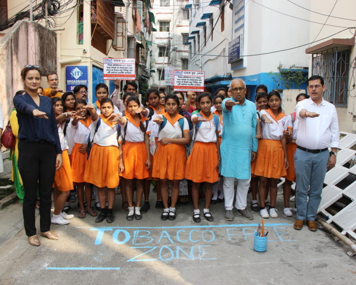Students taking an oath alongwith Madhabilata Mitra, Chairman, Borough X, Tapan Dasgupta and program manager TFWBC Indranil Dasgupta