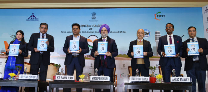 """The Minister of State for Housing & Urban Affairs, Civil Aviation (Independent Charge) and Commerce & Industry, Shri Hardeep Singh Puri releasing the publication at the Curtain Raiser Ceremony of """"WINGS INDIA-2020"""", in New Delhi on January 09, 2020. The Secretary (Civil Aviation), Shri Pradeep Singh Kharola and other dignitaries are also seen."""