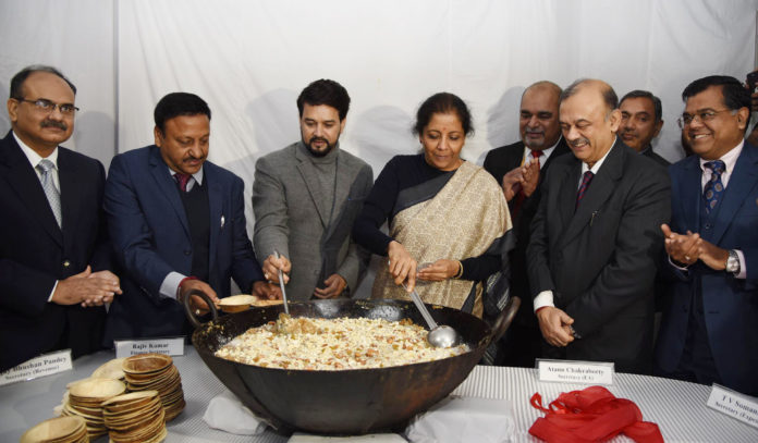 The Union Minister for Finance and Corporate Affairs, Smt. Nirmala Sitharaman at the Halwa ceremony to mark the commencement of Budget printing process for Union Budget 2020-21, in New Delhi on January 20, 2020. The Minister of State for Finance and Corporate Affairs, Shri Anurag Singh Thakur and other dignitaries are also seen.