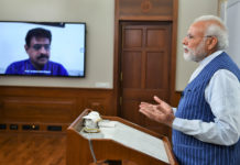 The Prime Minister, Shri Narendra Modi addresses the people of Varanasi on menace of Coronavirus through video conferencing, on March 25, 2020.