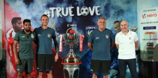 ATK FC and Chennaiyin FC Head Coaches, Antonio Lopez Habas and Owen Coyle along with captains Roy Krishna and Lucian Goian pose with the Hero ISL trophy ahead of the Final in Goa