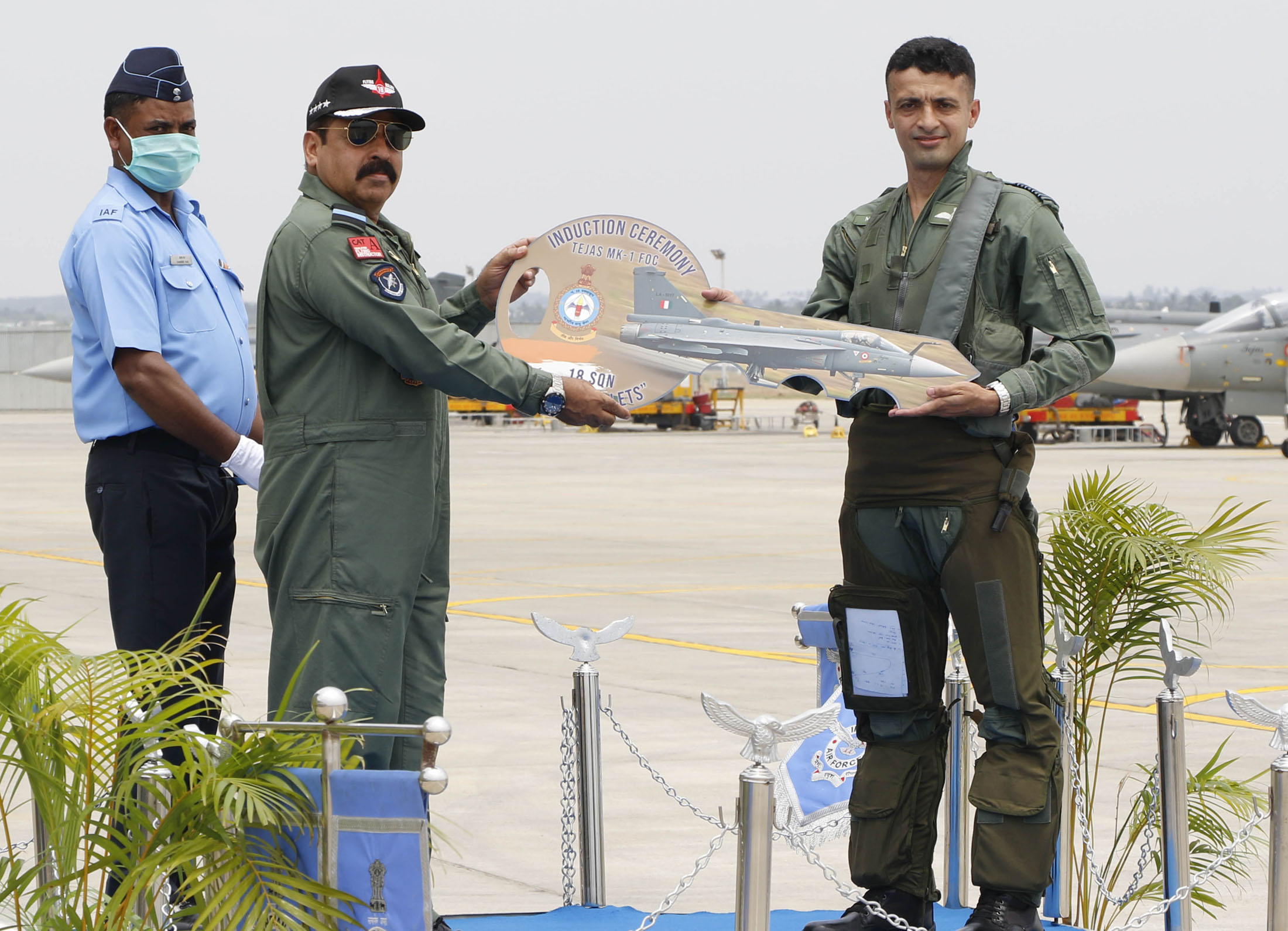 The Chief of the Air Staff, Air Chief Marshal R.K.S. Bhadauria handing over the ceremonial keys of the unit to the Commanding Officer of 18 Squadron Group Captain Manish Tolani, during the induction ceremony, at Air Force Station Sulur, in Tamil Nadu on May 27, 2020.