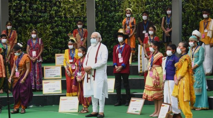 The Prime Minister, Shri Narendra Modi in a group photograph with the school children, during the inauguration of the Rashtriya Swachhata Kendra - an interactive experience centre on the Swachh Bharat Mission, at Rajghat, Delhi on August 08, 2020.