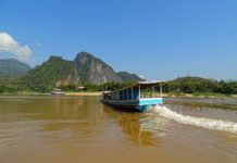 The Mekong River upstream from Luang Prabang, Laos. Boats like this one ferry passengers between Luang Prabang and the Pak Ou Caves.Photo by Wikipedia