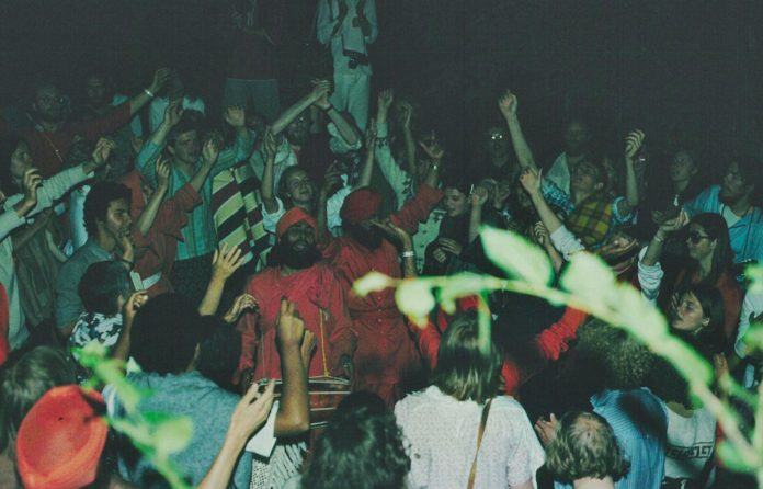 Photo (Italy July 1978) of an international group of Ananda Marga followers singing a Kirtan on the occasion of Shrii Shrii Anandamurti's liberation