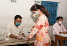 Polling official administering indelible ink to a voter, at a polling booth, during the fourth phase of the West Bengal Assembly Election, in Santoshpur, Kolkata, West Bengal on April 10, 2021.